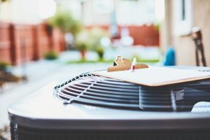 outdoor-ac-unit-with-clipboard-on-top